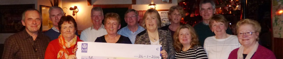 Members of Aghinagh Comhaltas making a presentation to Marymount Hospice charity