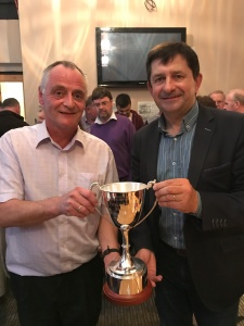 – (L to R)Michael O' Riordan presents the Patrick O Riordan Trophy to Cal Healy of the Coachford & District Trout Anglers Association